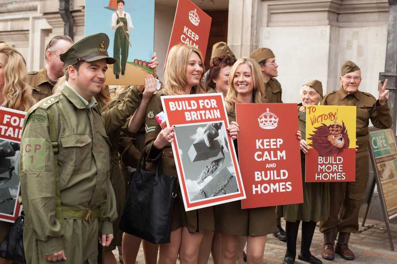 Derwent Living's team pose with wartime placards