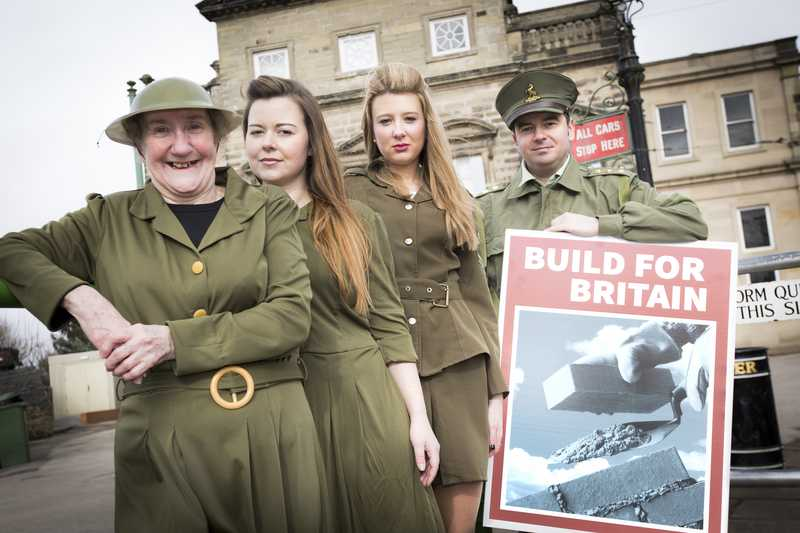 Customers and colleagues pose in WW2 costumes